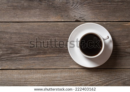 Coffee cup on wooden table. View from top  - stock photo
