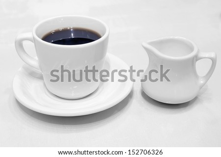 Coffee Cup Saucer Creamer Whiteware with Black Coffee - stock photo