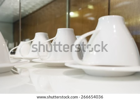 Coffee cup set on table for catering service - stock photo