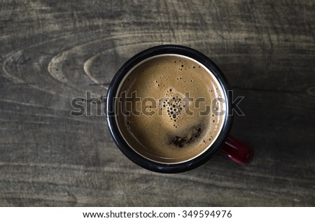 Coffee cup top view on wooden table background - stock photo