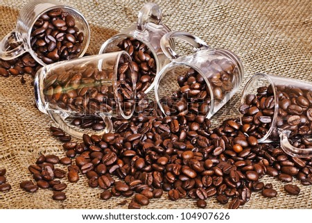 Coffee cup with beans - stock photo
