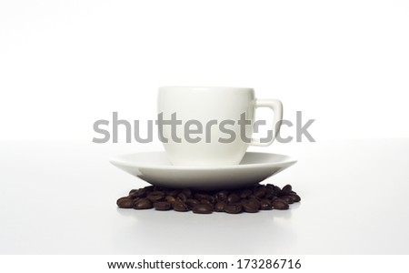 coffee cup with beans on white background - stock photo