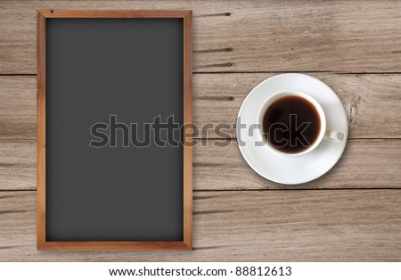 coffee cup with blank chalkboard on wood background