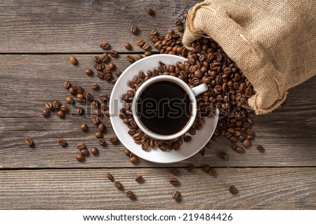 Coffee cup with coffee bag on wooden table. View from top. - stock photo