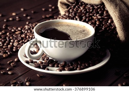 coffee cup with coffee beans - stock photo