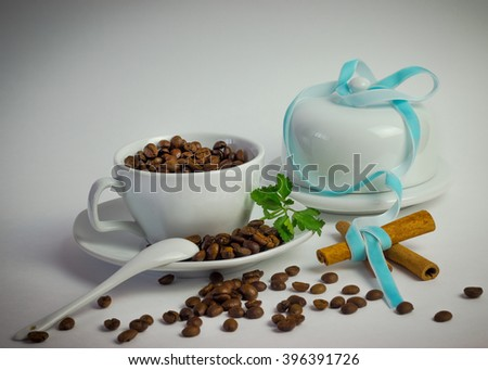 Coffee Cup with coffee beans and cinnamon. - stock photo