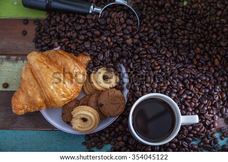 Coffee cup with cookies and beans - stock photo