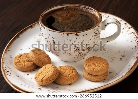 Coffee cup with cookies  on table