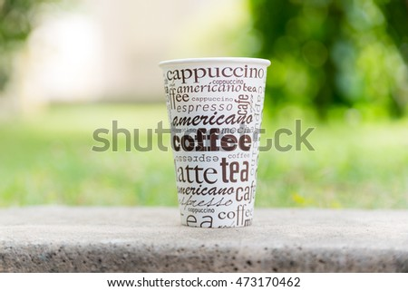 Coffee cup with green bokeh background