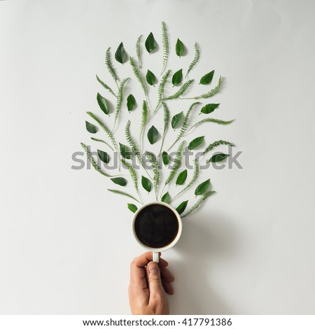 Coffee cup with leaves. Flat lay. Nature concept. - stock photo