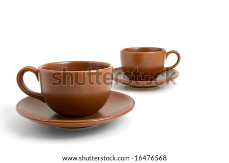 Coffee cups and saucers isolated on white background - stock photo