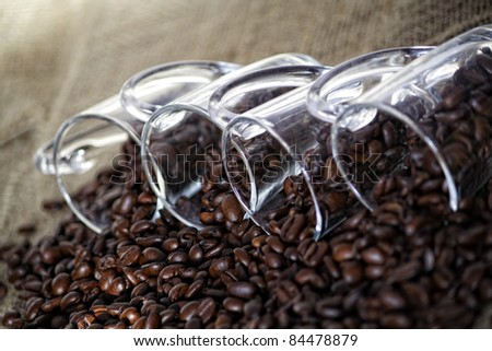 coffee cups with beans on background - stock photo