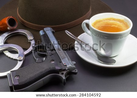 coffee detective, hat pipe gun and handcuffs - stock photo