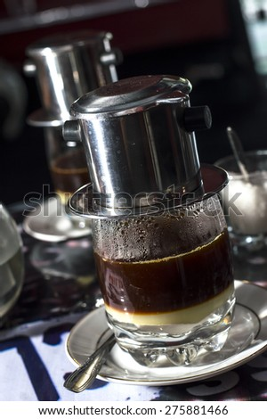 Coffee dripping in vietnamese style at a cafe - stock photo