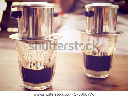 Coffee dripping in vietnamese style, retro filter effect - stock photo