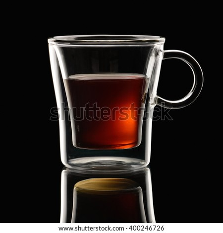 Coffee Espresso in transparent cup on black background - stock photo
