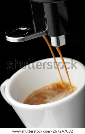 Coffee flowing from the nozzle automatic coffee maker. - stock photo