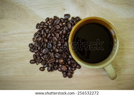 coffee foam cappuccino on old retro vintage aged wooden texture board table Good morning background - stock photo