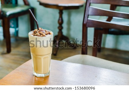 Coffee frappe with almond on top in coffee shop - stock photo