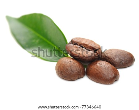 coffee grains and leaves isolated on white - stock photo