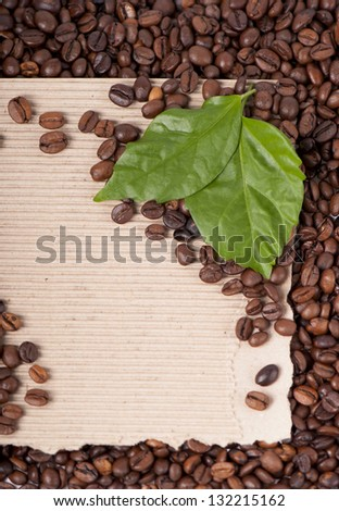 coffee grains and leaves on vintage background - stock photo