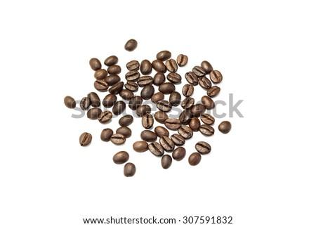 Coffee grains closeup on white background - stock photo