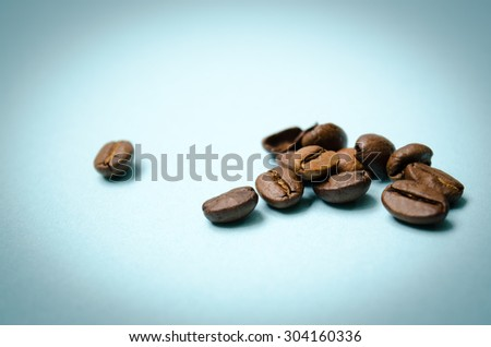 Coffee Grains on a Blue Background