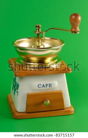Coffee grinder close-up Isolated on green background