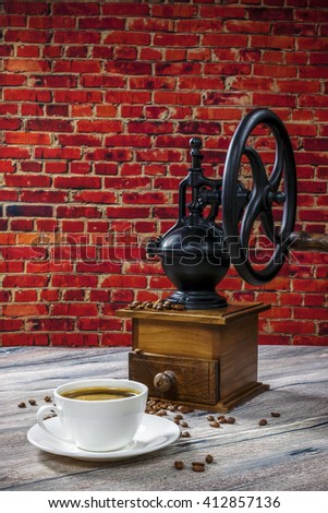 coffee grinder on the background of brick wall - stock photo
