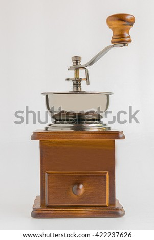 Coffee grinder placed on white background.