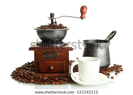 Coffee grinder, turk and cup of coffee with beans isolated on white - stock photo