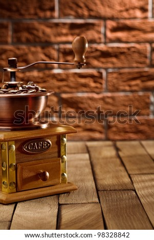 coffee grinder with beans on the table