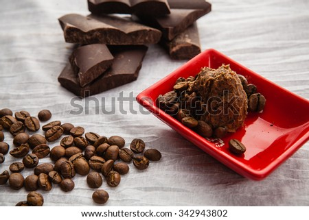 Coffee handmade soap in a red ceramic bowl on a white tablecloth - stock photo