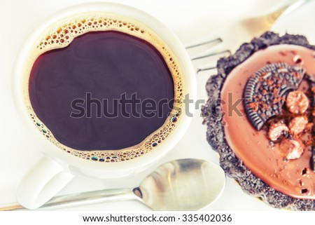 Coffee hot black vintage old and soft focus and chocolate cake.
