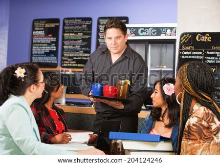 Coffee house server with drinks on tray for customers