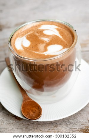 Coffee in a cup on wooden table