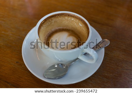 coffee in a cup, shallow depth of field - stock photo