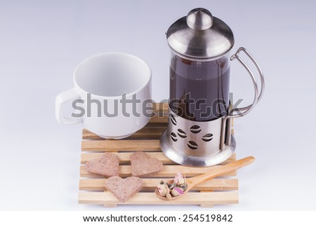 Coffee in a French press with take out cup on white - stock photo