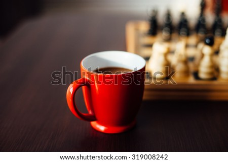 Coffee in a red cup for Chess players - stock photo