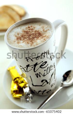 Coffee in a tall mug - stock photo
