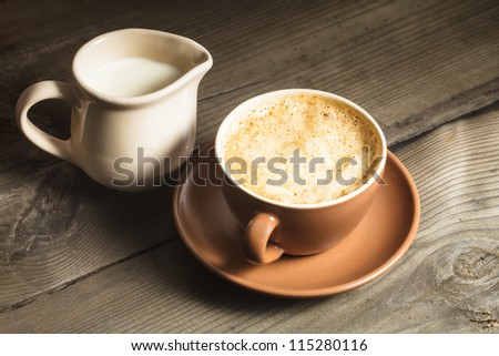stock photo coffee in brown cup and milk jug on tha table 115280116 Coffee Table Set Of  Free Picture White Ceramic Cup Black Coffee