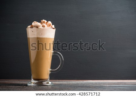 Coffee in glass on the rustic wooden background