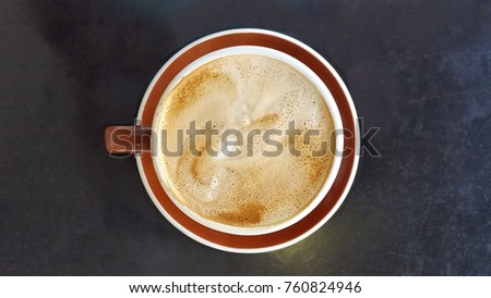 Coffee in red cup on black table
