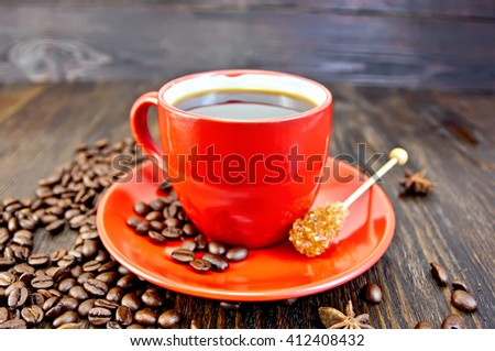 Coffee in red cup with sugar on a wooden boards background - stock photo