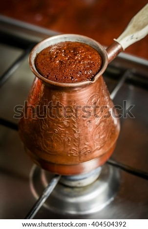 Coffee in Turkish on cook stove - stock photo