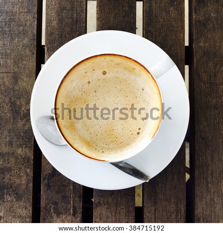 Coffee in white cup on wood table. - stock photo