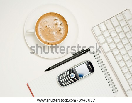 Coffee, keyboard, Pencil, Notepad, mobile phone.