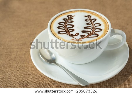 coffee latte art in coffee shop - stock photo