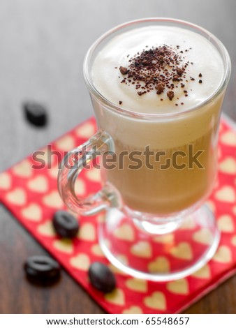 Coffee Latte in a glass mug with chocolate - stock photo