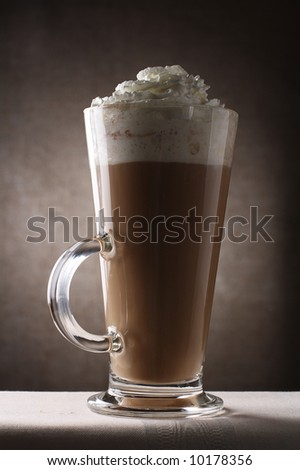 Coffee Latte in Tall Glass on brown rustic background, Low Key  Lighting Technique - stock photo